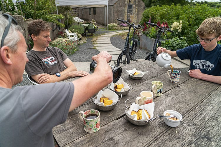 Three men enjoying afternoon tea at turnip cottage in the Mourne Mountains